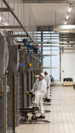 Men work at Hero factory in Spain, which is lit using Philips energy-saving LED lighting