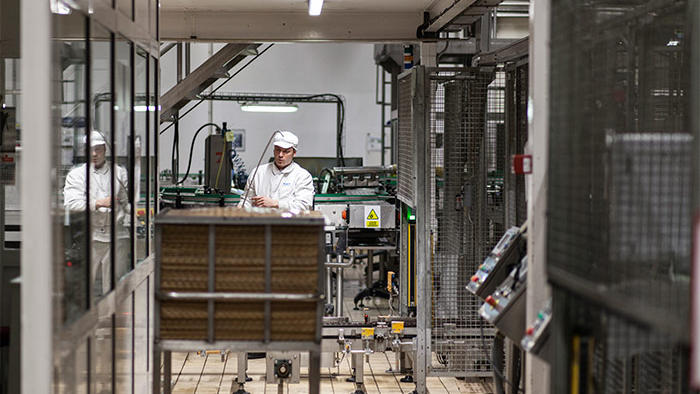 An employee works at Hero factory, illuminated by Philips energy-saving food industry LED lighting