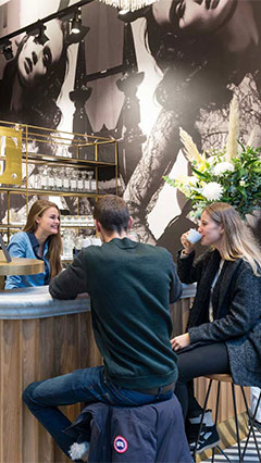 Philips lighting illuminates the coffee bar at the SuperTrash store in Amsterdam