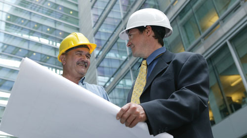An advisor and a worker discussing about a project