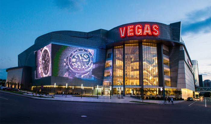 Vegas Crocus City shopping mall in, Moscow, Russia, featuring large and brightly colored billboards